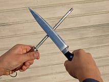 3 noży ostrzenie Obrazy Stock