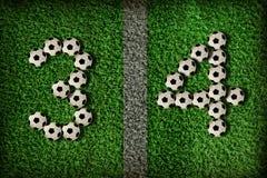 3 nummer för 4 fotboll Royaltyfria Foton