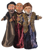 3 Old Russian Men Puppets. Group of three traditionally dressed old Russian men puppets with fur hats and beards isolated on white background stock photos
