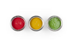 3 Paint cans. Three paint tins in traffic light colours Royalty Free Stock Photo
