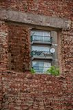 3-panel Windows With Fences on Red Brick Building stock photo