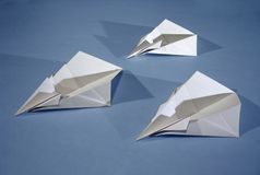 3 paper aircrafts. Three origami aircrafts royalty free stock images