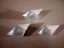 3 paper boats on bronze. Three origami paper boats on bronze stock image