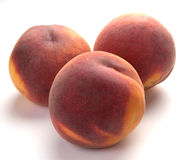 3 peaches Stock Photos