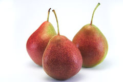 3 Pears. Three juicy red pears on white royalty free stock photo