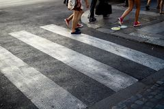 Free 3 People Crossing A White Zebra Crossing, On A Grey Tarmac Road, In Central Rome Italy Stock Photos - 109998993