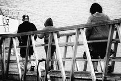 3 Person Walking on Bridge Black and White Photo Royalty Free Stock Image