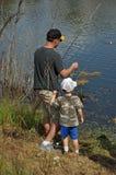 3 pesci del ragazzo insegnano a a Fotografia Stock