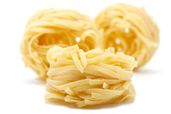 3 pieces of pasta - Farfalle. Stock Photo