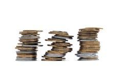 3 pilas de las monedas aisladas Imagenes de archivo