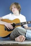 3 pojkegitarrspelrum Fotografering för Bildbyråer