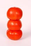 3 pomodori impilati Fotografia Stock