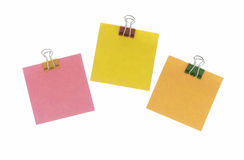 3 post-its hanging on white. 3 colorful post-its hanging from binder clips on white background Royalty Free Stock Photography
