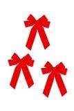 3 röda bows Arkivfoto