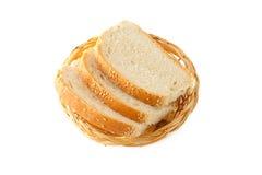 3 rebanadas de pan en una placa de mimbre. Aislado Fotografía de archivo