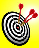 3 red darts stick on a dartboard. 3 Darts stick to bullseye on a dartboard Royalty Free Stock Photos