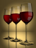 3 red Wine glasses. 3 glasses of red wine on a lit background Royalty Free Stock Image