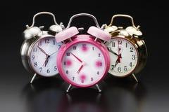 3 relojes de alarma Foto de archivo libre de regalías