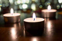 Free 3 Romantic Tea Lights For Dinner On Wooden Table With Bokeh At Night Stock Images - 68886194