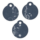 3 round tags with flowers. 3 beautiful round tags or labels with flowers and curls Royalty Free Stock Photography