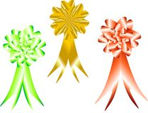 3 rounded bows with ribbons tails. Group of red, gold and green metallic rounded bows, for all occasions Royalty Free Stock Photos
