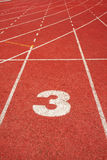 3 on a running track  line Stock Photos