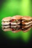 3 sandwichs populaires sur le vert Images libres de droits