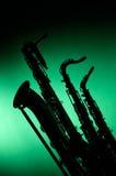 3 saxofones en silueta Imagen de archivo libre de regalías