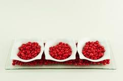 3 schotels met rood suikergoed stock fotografie