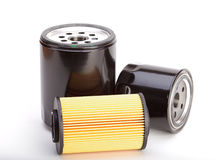 3 seuls filtres à huile sur un fond blanc Photo stock