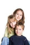 3 siblings. On a white background Royalty Free Stock Photography