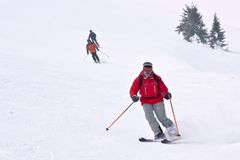 3 skiers running down from hill. On European mountain resort Royalty Free Stock Photos