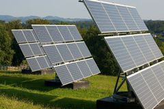 3 Solar Panels on meadow. 3 times 9 solarpanels in group of 9 heading to sun Stock Image