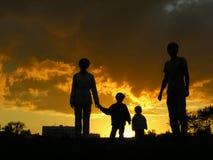 3 solnedgång för familj fyra royaltyfri fotografi