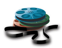 3 spools with tape. Different colors. 3 old spools with tape. Photo, video or audio tape.  Different colors Stock Photo