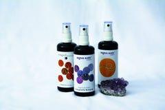 3 Spray Bottles Near Purple Geode Stock Photography