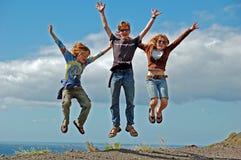 3 sprong voor Vreugde Stock Fotografie