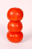 3 Stacked Tomatoes. A group of tomatoes stacked like a snowman stock photo