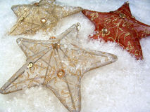 3 Stars in Snow. 3 star ornaments on snow Royalty Free Stock Photography