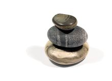 3 stones. Balanced on white background stock photos