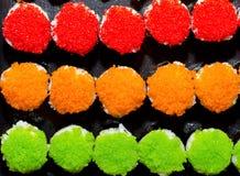 3 sushi di colori, verde arancio rosso Fotografia Stock Libera da Diritti