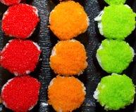 3 sushi di colori, verde arancio rosso Immagini Stock Libere da Diritti
