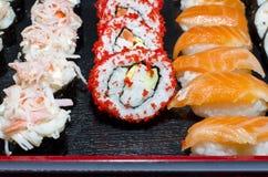 3 sushi di riga Fotografia Stock