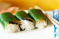 3 sushi and sticks Royalty Free Stock Photo