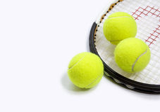 3 tennis balls and a racket Stock Photography