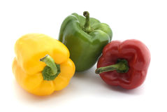 3 / three peppers - red, green and yellow on white Stock Photos