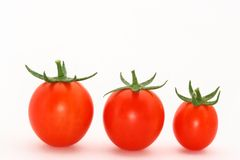 3 tomates de cereja Fotografia de Stock Royalty Free