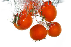 3 tomatoes falling in water Royalty Free Stock Images