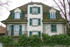 3 trevliga schweizare för hus Arkivbilder