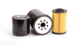 3 unique oil filters on a white background Royalty Free Stock Images